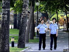 Two policewomen patrol in Ritan Park on 3 August 2008