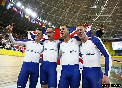 Geraint Thomas, Bradley Wiggins, Paul Manning and Ed Clancy celebrate claiming gold for Britain