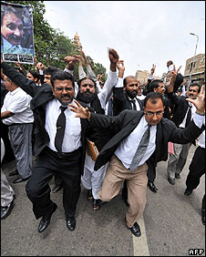 Pakistani lawyers dance in jubilation in Karachi