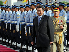 President Pervez Musharraf inspects a guard of honour before leaving his palace on  18 August