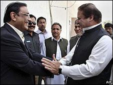 Coalition leaders Asif Ali Zardari (left) and Nawaz Sharif shake hands on 18 August at news of President Musharraf's resignation