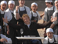 Jamie Oliver (centre) and trainee chefs