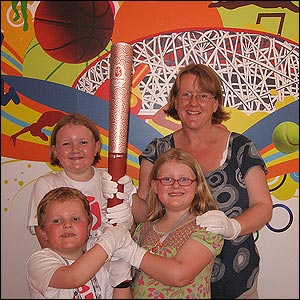 The Wiltshie family went to Chaoyang Park and ended up in the Shuang Zone VIP area holding the torch