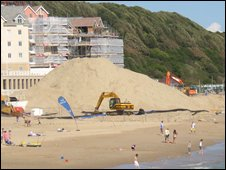 Pile of sand on Boscombe beach waiting to be pumped