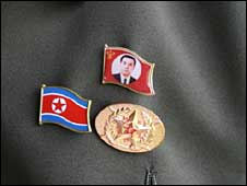 Badges of the North Korean flag and late Great Leader Kim Il Sung worn on a North Korean's lapel (pic courtesy North Korea Economy Watch)