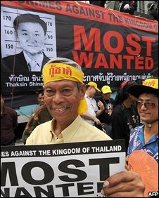 Members of the People's Alliance for Democracy holding protest posters  in Bangkok on 19 August