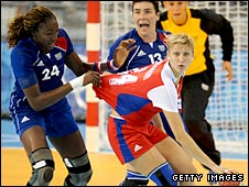 Mariama Signate of France grabs the shirt of Irina Bliznova of Russia