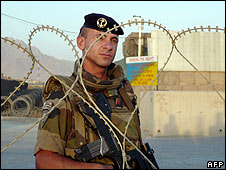 A French soldier guards a base in Kabul used by some of the troops killed 