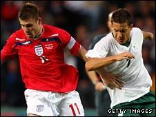 England U21 goalscorer James Milner (left) competes for the ball with Slovenia's Goran Cvijanovic