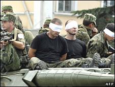 Captive Georgians atop of a Russian tank in Poti, Georgia, on 19 August 2008