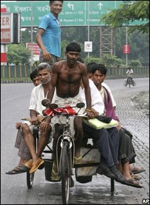 Calcutta workers on a transport rickshaw