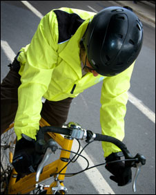 Cycling gear - helmet, luminous jacket, gloves