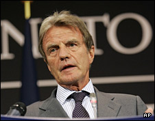 Bernard Kouchner addresses the media at NATO Headquarters