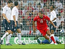 Czech Rep striker Milan Baros reels away after giving his side the lead against England