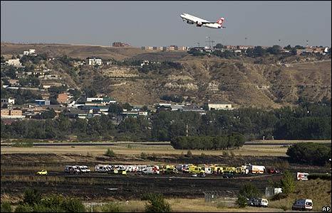 A plane takes off near the Spanair crash site