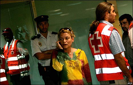 A relative of crash victim speaks on the phone at the Las Palmas airport in the Canary Islands