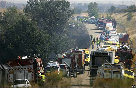 Emergency rescue vehicles at the site of the plane crash