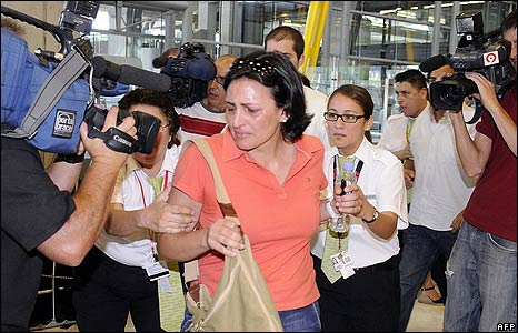 A relative of crash victims arrives at the Barajas airport in Madrid