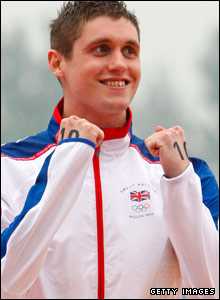 David Davies shows his delight on the podium in Beijing