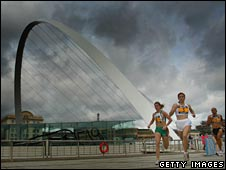 Runners pass the Gateshead bridge