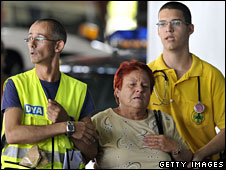 Relatives of the victims of Wednesday's Spanair plane crash arrive at the convention centre where the crash victims� remains are being held in Madrid, Spain, 21 August