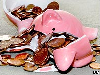 Copper coins spilling out of a broken piggy bank