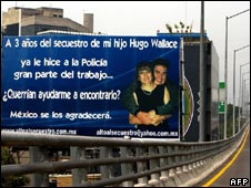 Miranda Wallace uses a billboard in Mexico City to appeal for help to find her son Hugo Wallace abducted three years ago
