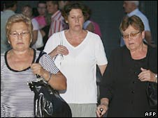 Relatives  leave after a memorial mass for victims of the crash in Madrid