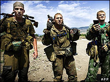 Three Russian snipers argue with Georgian demonstrators at a checkpoint in Igoeti, 35km from Tbilisi, on 21 August