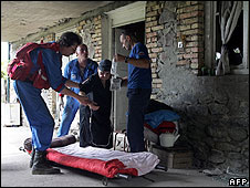 Russian emergencies workers help an ethnic Georgian woman, 98, being evacuated from a village in South Ossetia to Gori in Georgia proper