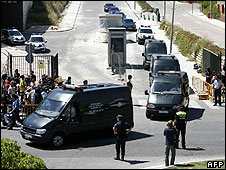 Vans carry victims of the Madrid plane crash