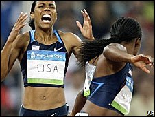 America's Torri Edwards, left, and Lauryn Williams drop the baton in the women's 4x100m relay