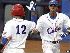 Cuba's Hector Olivera is congratulated by Michel Enriquez