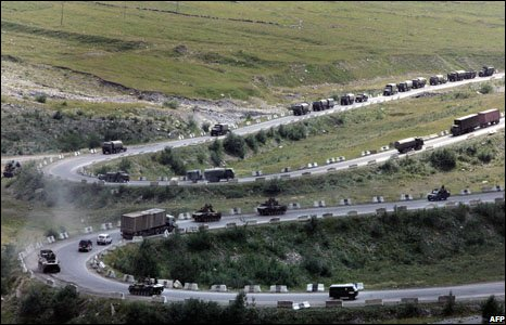 A column of Russian troops in tanks and trucks drive toward the Russian border near the town of Ruk in the South Ossetian breakaway region, 22 August, 2008.