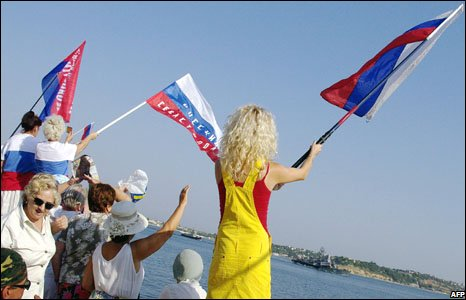 Supporters of pro-Russian parties wave Russian flags as they welcome Russian missile-firing boat Mirage as it enters Sevastopol bay, 22 August, 2008.