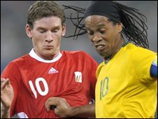 Ronaldinho vies for a ball against Jan Vertonghen
