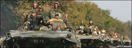 Russian troops ride armoured personnel carriers near Igoeti