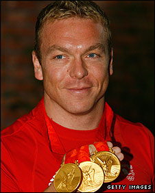Chris Hoy shows off his medal haul from Beijing