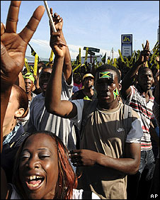 Jamaicans celebrate Usain Bolt in Kingston on 22 August