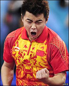 Wang Hao celebrates victory