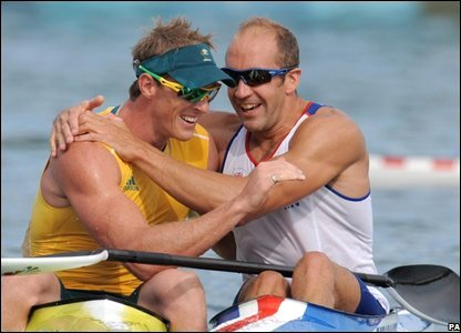 Tim Brabants celebrates his second medal of the Games but it is a bronze this time in the 500m kayak behind Australia's Ken Wallace