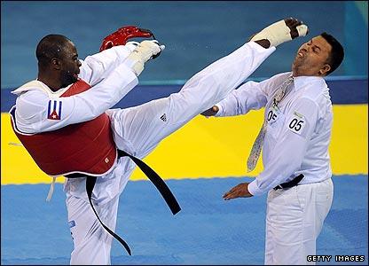Cuba's former Olympic champion Angel Valodia Matos kicks referee Chakir Chelbat in the head