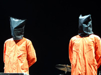 The band hooded wearing orange boiler suits