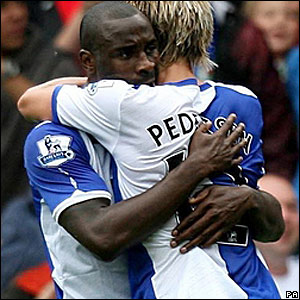 Roberts celebrates with Morten Gamst Pedersen