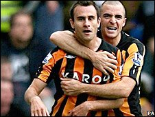 Richard Garcia (left) celebrates his goal for Hull with Dean Marney