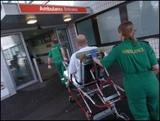 Ambulance staff with a patient