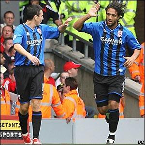 Mido celebrates his goal