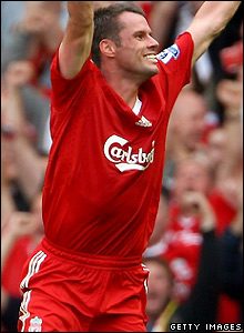 Carragher celebrates a rare goal