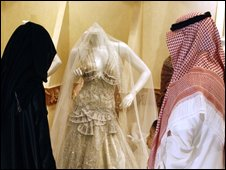 A couple look at a wedding dress in Riyadh, file image