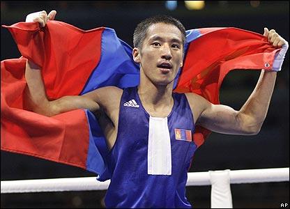 Mongolia's Badar-Uugan Enkhbat celebrates winning bantamweight gold
